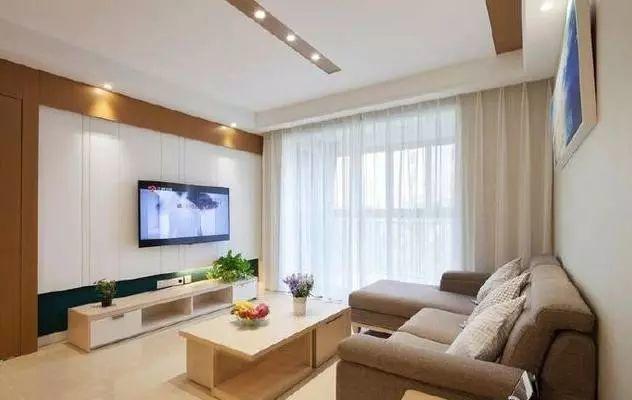 电视背景墙,风格简约清新,上方和左侧都是采用的木板作为边框装饰,中