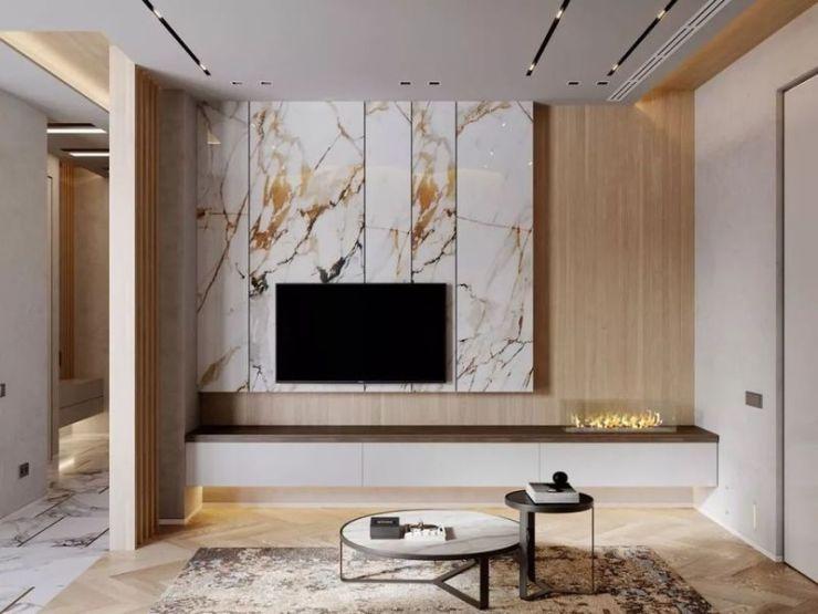 从地板到电视墙背景,大理石材的花纹都做得非常自然.